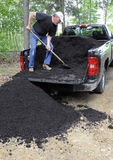 Man unloading compost Royalty Free Stock Images