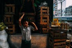 Man unloading crates in Yangon. Royalty Free Stock Photos