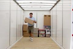 Free Man Unloading Portable Storage Unit Royalty Free Stock Photo - 31553255