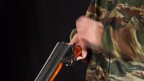 Man unloads hunting rifle stock video