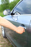 Man unlock car door by key Royalty Free Stock Photography