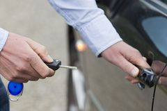 Man Unlocking Car Door. Stock Photography