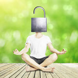 Man unlocking mind to find new solutions. Meditating man with open iron lock instead of head on green background. Unlocking mind to find new solutions Royalty Free Stock Photos