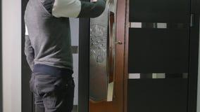 A man unlocks a door in shop.  stock video footage
