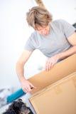 Man unpacking a cardboard carton Royalty Free Stock Photo