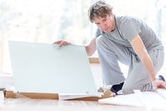 Man unpacking flat pack components Stock Photography