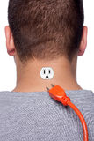 Man Unplugged. Conceptual image of a young man with an electrical socket on the back of his neck with the power plug disconnected stock photo