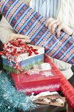 Man Unrolling Wrapping Paper Royalty Free Stock Images