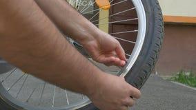 Man Unscrew Bike Wheel Valve Cap. Man is unscrew the bicycle wheel valve cap, preparing it for inflation stock video