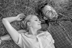 Man unshaven and girl lay on grass meadow. Closer to nature. Guy and girl happy carefree enjoy freshness of grass stock photos