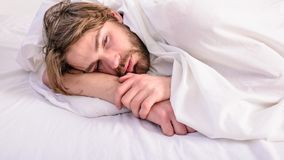 Man unshaven handsome relaxing bed. Man sleepy drowsy unshaven bearded face covered with blanket having rest. Guy lay. Under white bedclothes. Fresh bedclothes stock photos