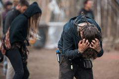A man untangle his hair at the Lost Theory psytransce music festival held in Riomalo de Abajo
