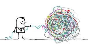 man untangling a knot Stock Photo