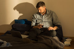 Man in untidy bed Stock Photography