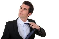 Man untying his tie Stock Photo