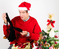 Man unwrapping a Christmas gift Stock Photos