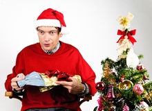 Man unwrapping a Christmas gift Royalty Free Stock Photography