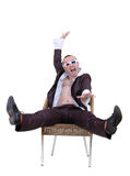 Man in the unzipped shirt on a chair Royalty Free Stock Photo