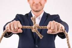 Man upholding knotted rope Royalty Free Stock Photography