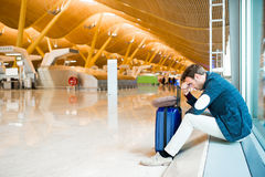 Man upset, sad and angry at the airport his flight is delayed stock images