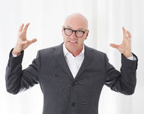 Man is upset. Bald-headed man in a suit is upset Stock Photos