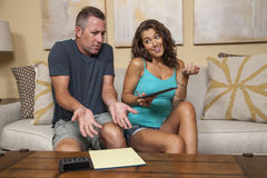 Man upset about budget and girl doesnt know why. Couple tries to work out the budget stock photo