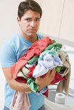 Man Upset Doing Laundry Royalty Free Stock Photos
