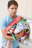 Man Upset Doing Laundry Royalty Free Stock Photos