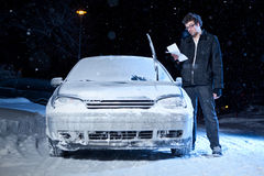 Man upset after getting a parking ticket. Man upset after getting a night parking ticket during the winter Stock Image
