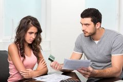 Man upset after looking at card statement. Royalty Free Stock Image