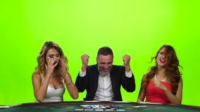 Man upset of two beautiful girls - beat their cards stock footage