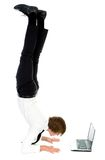Man upside down using laptop Royalty Free Stock Photos