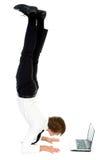 Man upside down using laptop royalty free stock photos