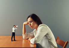 Man urge on tired businesswoman. Small men urge on tired businesswoman Stock Photos