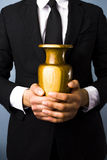 Man with urn Royalty Free Stock Images