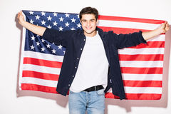 man with US flag in hands on white. USA Patriotism. Stock Photography