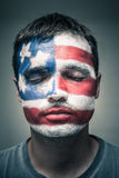 Man with USA flag on face and closed eyes. Portrait of man with USA flag painted on his face and closed eyes Stock Photography