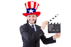 Man with USA hat and movie board isolated Stock Image