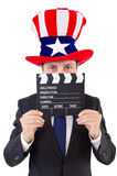Man with USA hat and movie board isolated Stock Photography