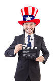 Man with USA hat and movie board isolated Stock Images