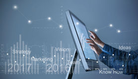 Man Use computer, businessman hand touch screen graph statistic. Interface with virtual icon market stock, business strategy concept Royalty Free Stock Images