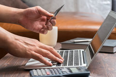 Man use credit card to buy product on laptop Royalty Free Stock Image