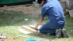 Man use cutting machine cut quarry tile at garden stock video footage