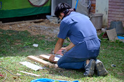 Man use cutting machine cut quarry tile at garden Stock Image