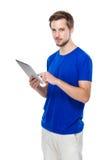 Man use of digital tablet Stock Photo