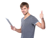 Man use of digital tablet and thumb up Royalty Free Stock Photos