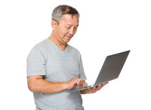 Man use of laptop computer Stock Images