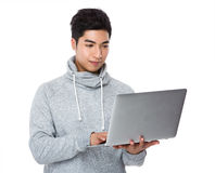 Man use of the notebook computer Stock Images