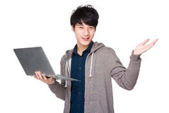 Man use of notebook computer and open hand palm Stock Photo