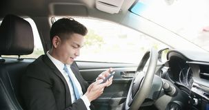 Man use phone in car stock image